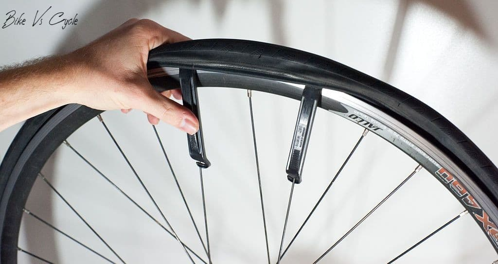 """Pulling out the tire""Best Hybrid Bike Tires"